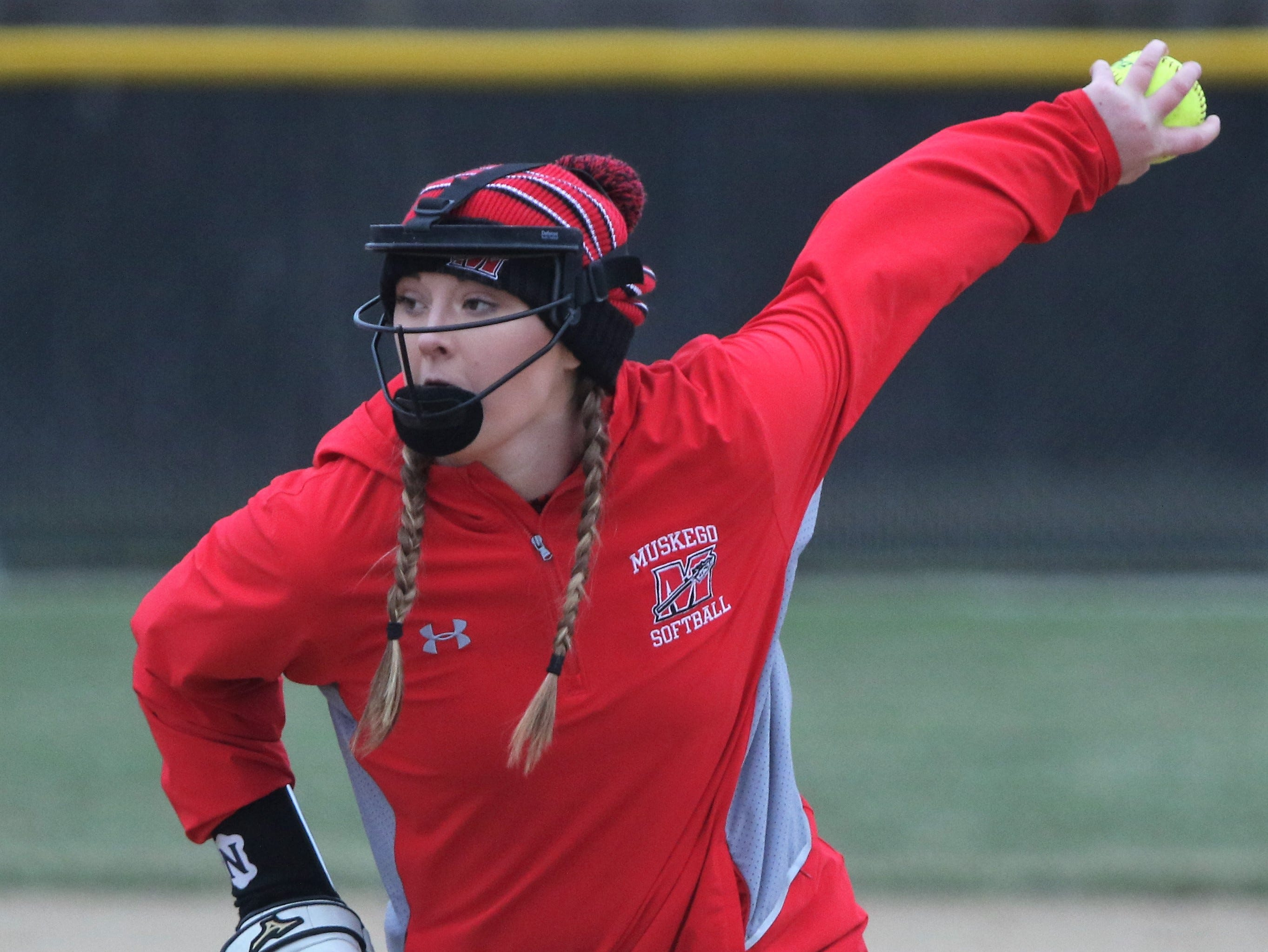 Muskego pitcher Jordan Caby winds up to deliver a pitch against Waukesha North on April 12, 2019.