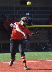Viola's Lindsey Browning fires a throw to first base on Friday night.