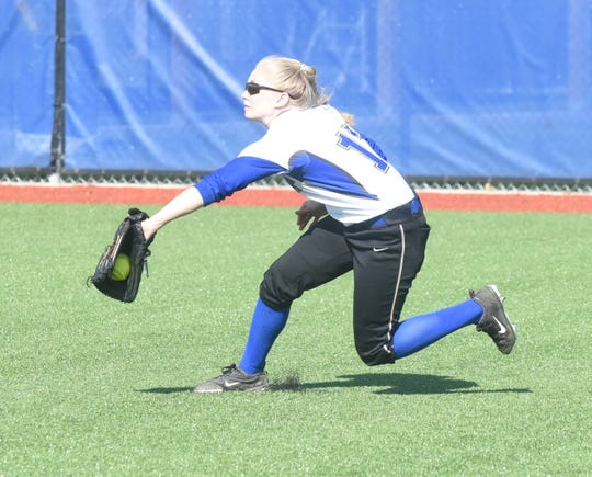 Mountain Home right fielder Gracie Uchtman makes a running catch during the Lady Bombers' victory over Viola on Friday.