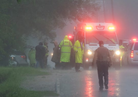 A Ouachita Sheriff's deputy stands in the 700 block of Evergreen St. in West Monroe, La. after a juvenile fell into a drainage canal and the high water collected there by the storms that passed over Northeast Louisiana on April 13. According to Ouachita Parish Sheriff's spokesperson Glenn Sprinfield the victim drowned and the body has yet to be recovered.