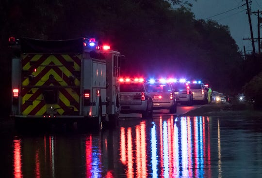 Emergency vehicles line the 700 block of Evergreen St. in West Monroe, La. after a juvenile fell into a drainage canal and the high water left by the storms that passed over Northeast Louisiana on April 13. According to Ouachita Parish Sheriff's spokesperson Glenn Sprinfield the victim drowned and the body has yet to be recovered.
