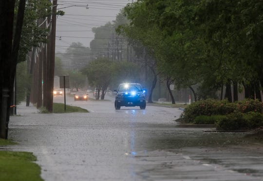 A Monroe police cruiser blocks traffic from passing through the flooded intersection of Forsythe Ave. and Sycamore St. in Monroe, La. after severe storms passed through Northeast Louisiana on April 13. The Garden District had numerous streets flooded from the heavy rains.