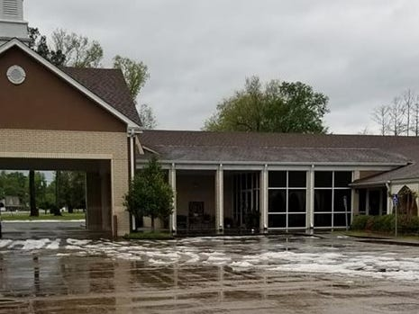 Hail still dotted the parking lot of St. Mark's church in Swartz around 9 a.m. Saturday morning.