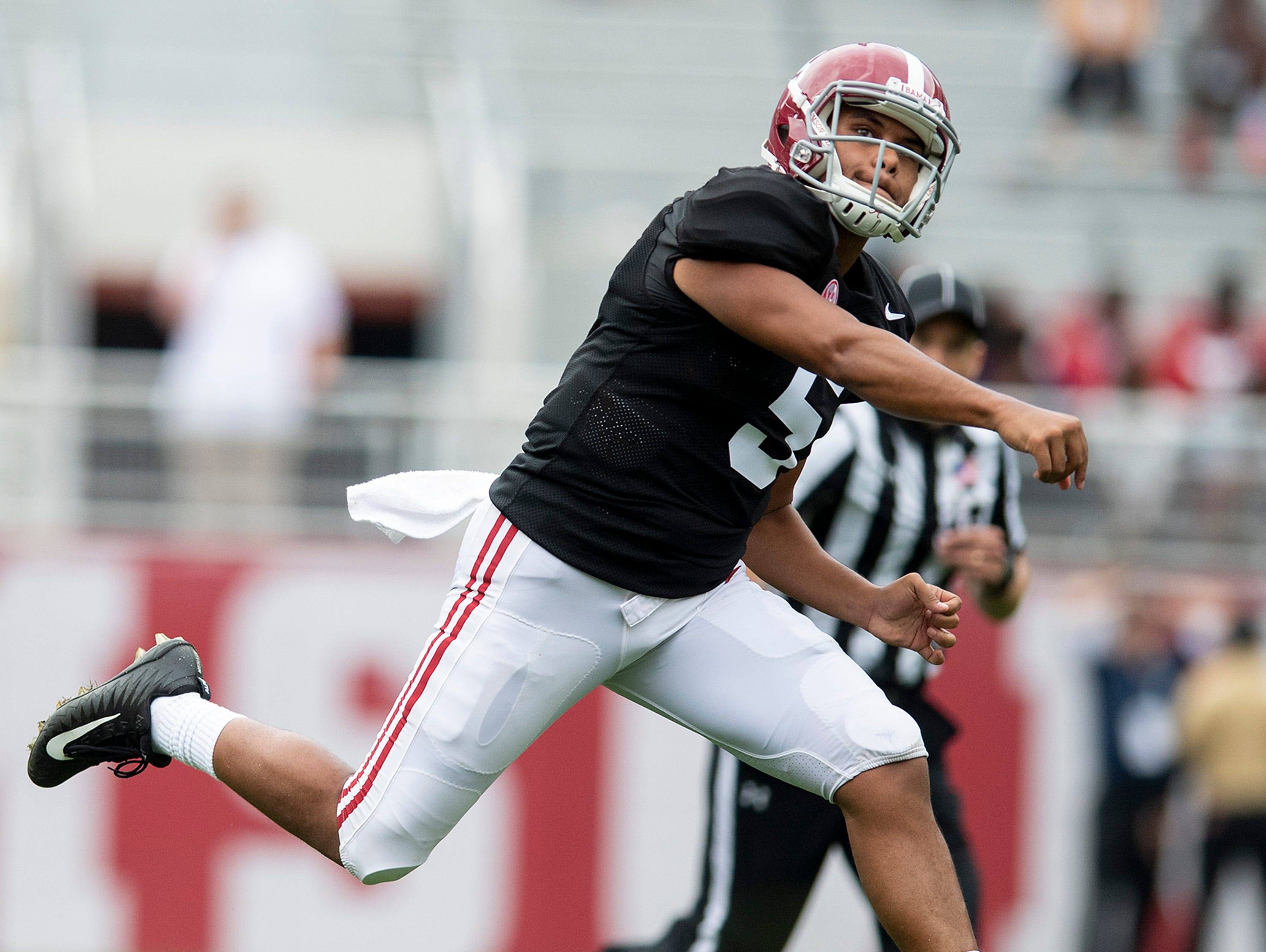 Alabama quarterback Taulia Tagovailoa (5)  passes during second half action in the Alabama A-Day spring football scrimmage game at Bryant Denny Stadium in Tuscaloosa, Ala., on Saturday April 13, 2019.