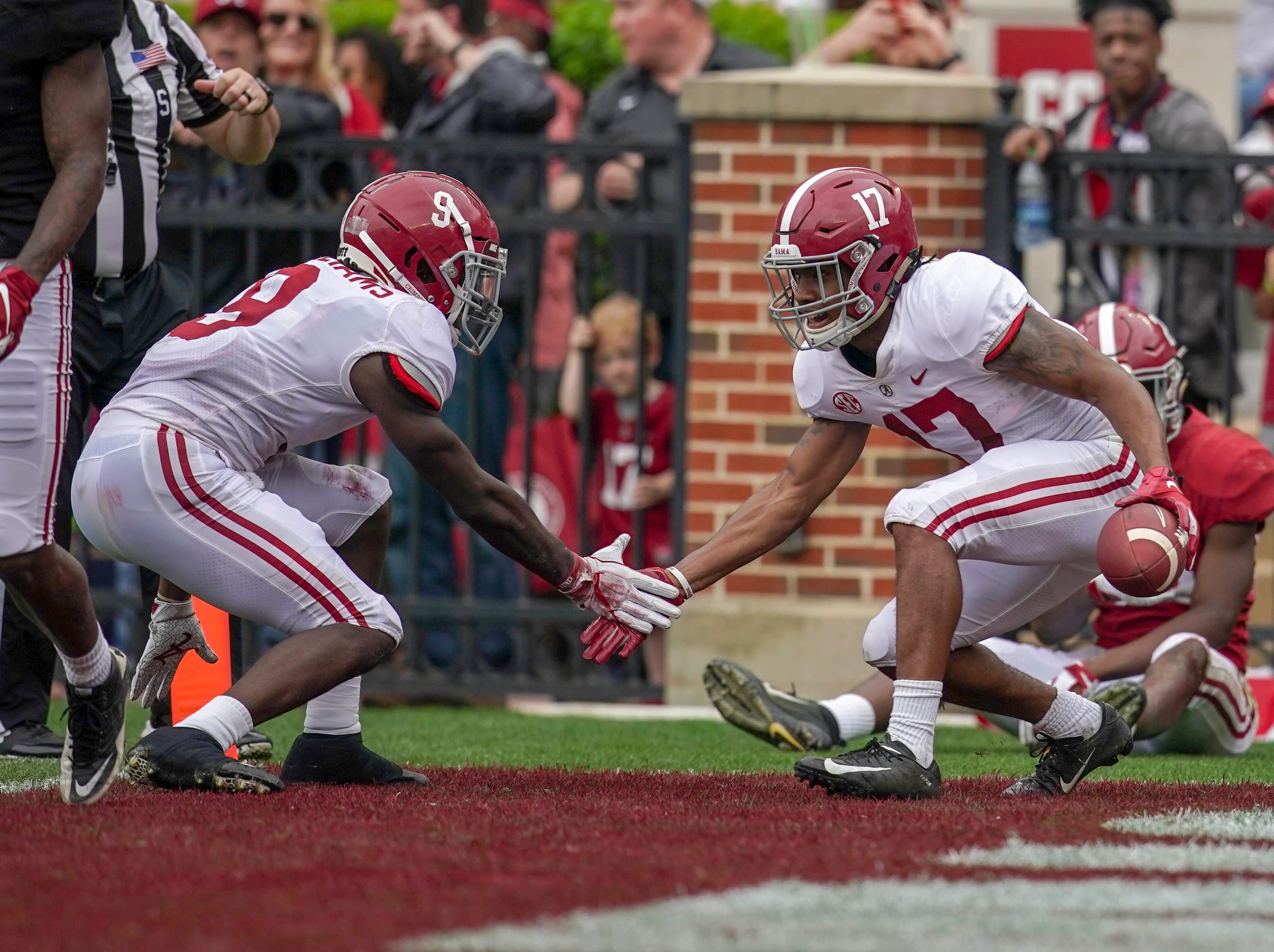 Apr 13, 2019; Tuscaloosa, AL, USA; Alabama Crimson Tide wide receiver Jaylen Waddle (17) celebrates with Alabama Crimson Tide wide receiver Xavier Williams (9) after Waddle scored a touchdown in the spring game at Bryant-Denny Stadium. Mandatory Credit: Marvin Gentry-USA TODAY Sports