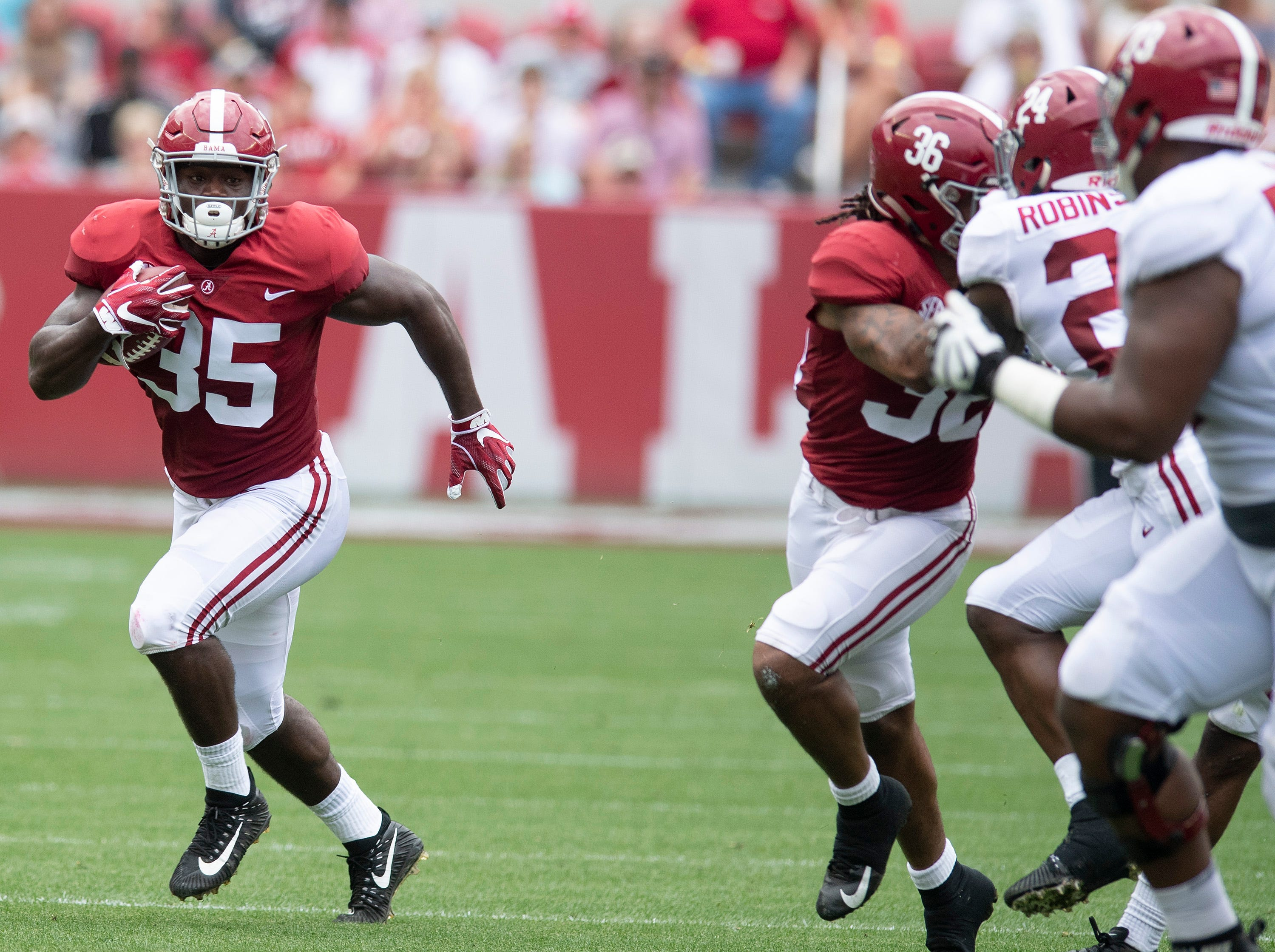 Linebacker Shane Lee (35) returns an interception during first half action in the Alabama A-Day spring football scrimmage game at Bryant Denny Stadium in Tuscaloosa, Ala., on Saturday April 13, 2019.