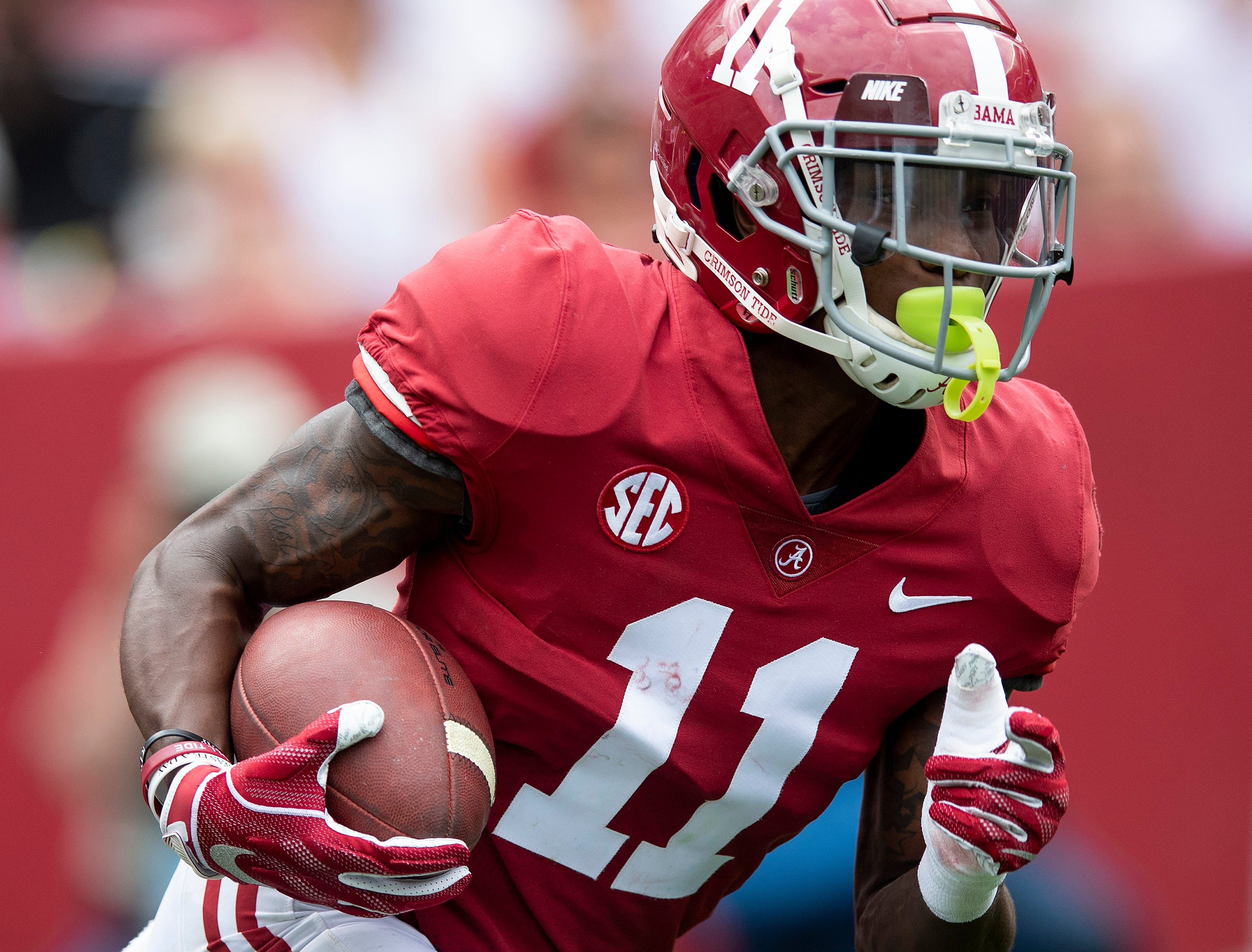Alabama wide receiver Henry Ruggs, III, (11) returns a kick during first half action in the Alabama A-Day spring football scrimmage game at Bryant Denny Stadium in Tuscaloosa, Ala., on Saturday April 13, 2019.