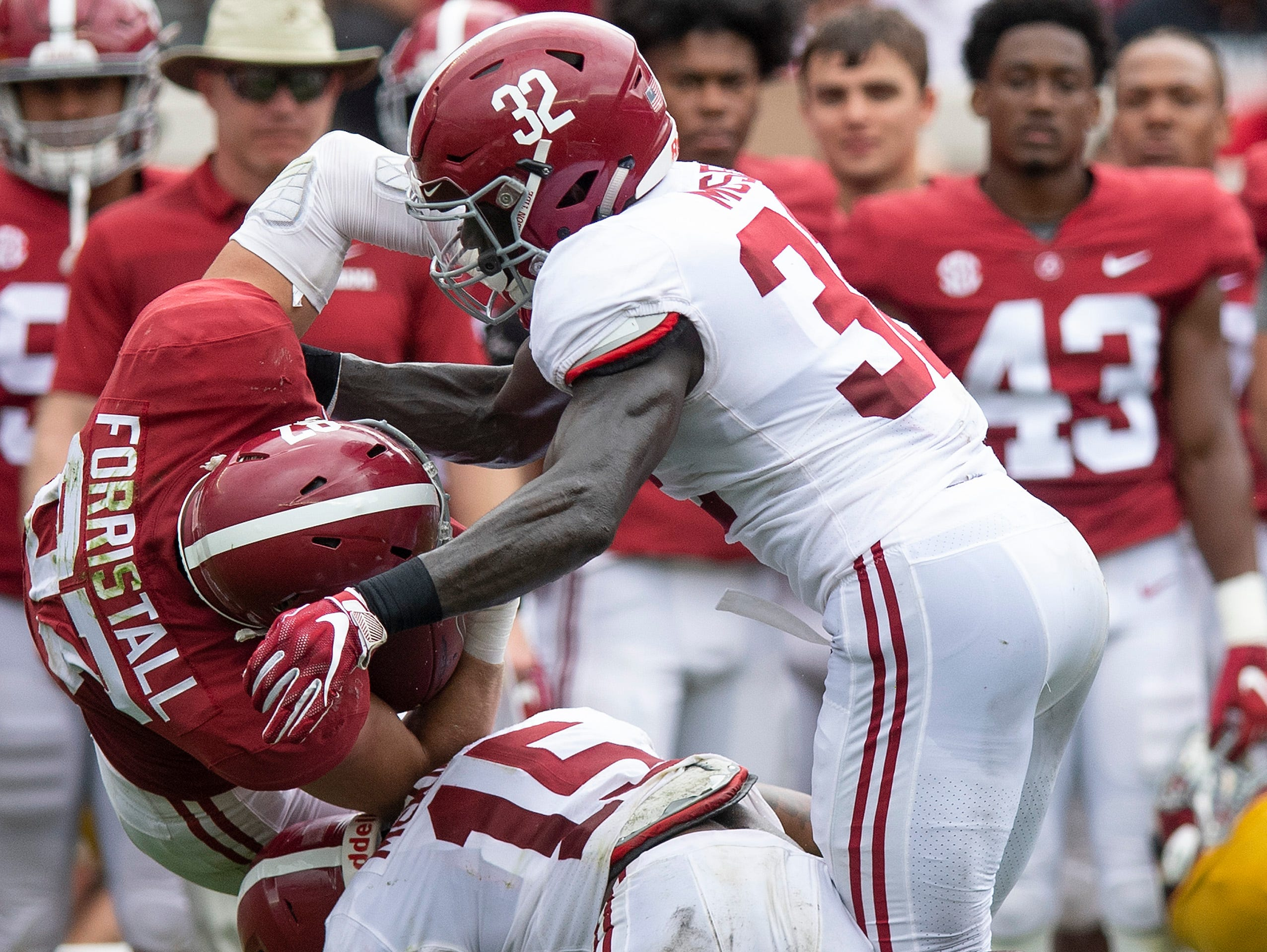 Linebacker Dylan Moses (32) and linebacker Dylan Moses (32) stop tight end Miller Forristall (87) during first half action in the Alabama A-Day spring football scrimmage game at Bryant Denny Stadium in Tuscaloosa, Ala., on Saturday April 13, 2019.