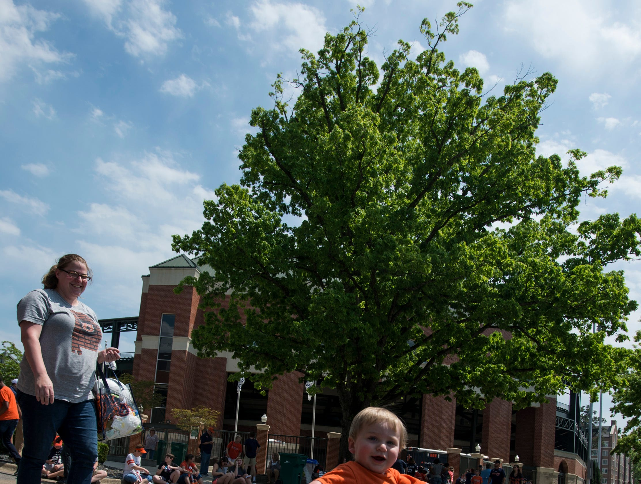 Alexander Hardy, 1, runs across the road with his shaker during the A-Day spring practice gameat Jordan-Hare Stadium in Auburn, Ala., on Saturday, April 13, 2019.