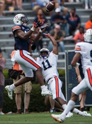 Auburn wide receiver Seth Williams (18) catches a pass over Auburn defensive back Zion Puckett (11) during the A-Day spring practice gameat Jordan-Hare Stadium in Auburn, Ala., on Saturday, April 13, 2019.