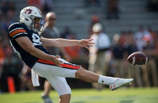 Auburn punter Arryn Siposs (90) punts the ball during the A-Day spring game at Jordan-Hare Stadium in Auburn, Ala., on Saturday, April 13, 2019.