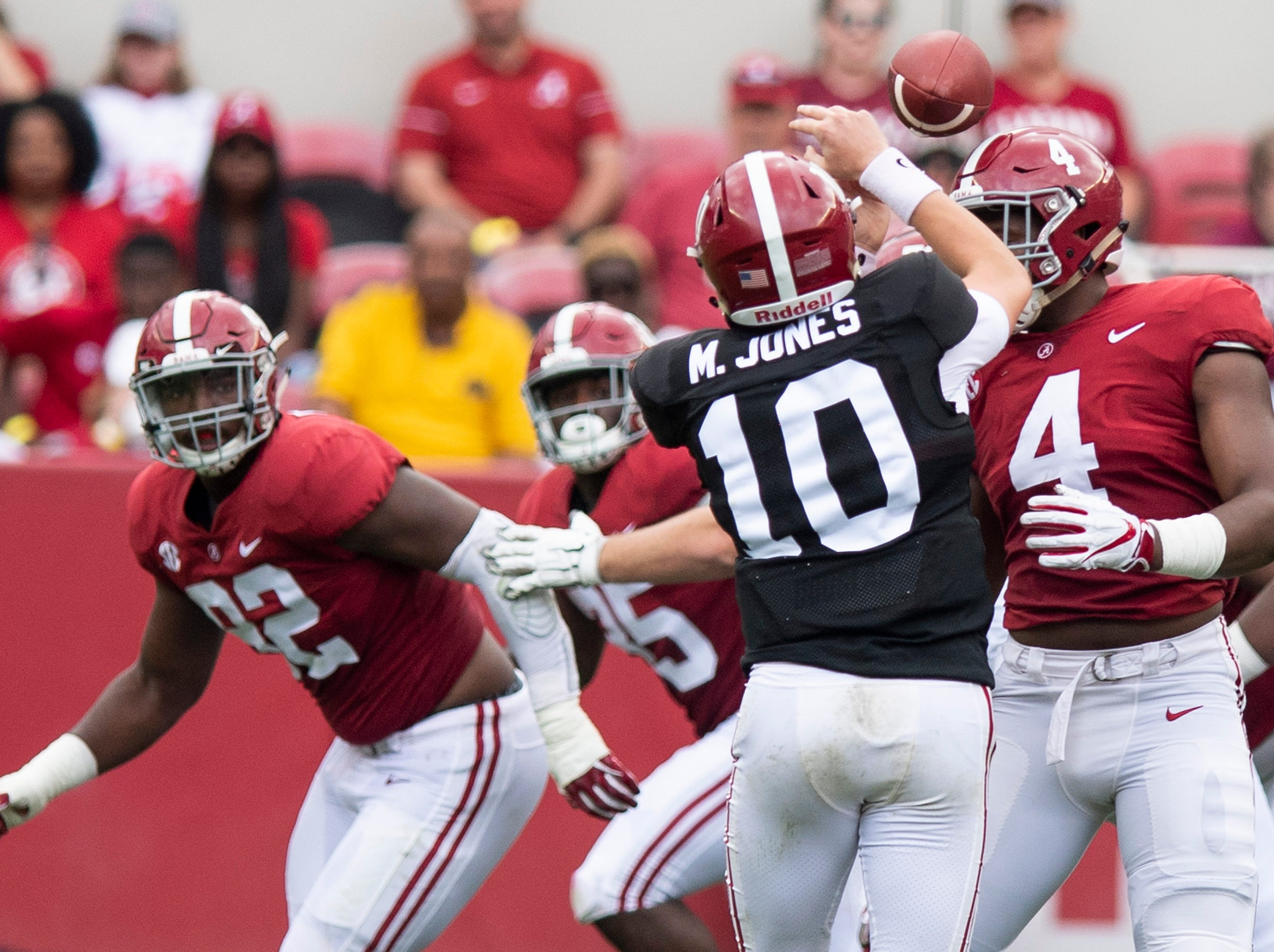 Linebacker Christopher Allen (4) breaks up a pass by quarterback Mac Jones (10) during first half action in the Alabama A-Day spring football scrimmage game at Bryant Denny Stadium in Tuscaloosa, Ala., on Saturday April 13, 2019.