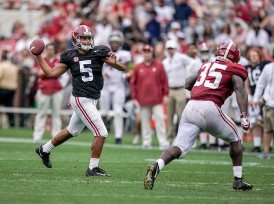 Apr 13, 2019; Tuscaloosa, AL, USA; Alabama Crimson Tide quarterback Tualia Tagovailoa (5) looks down field during the spring game at Bryant-Denny Stadium. Mandatory Credit: Marvin Gentry-USA TODAY Sports