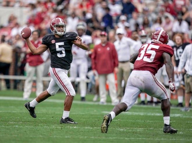 Apr 13, 2019; Tuscaloosa, AL, USA; Alabama Crimson Tide quarterback Tualia Tagovailoa (5) looks down field during the spring game at Bryant-Denny Stadium. Mandatory Credit: Marvin Gentry-USA TODAY Sports