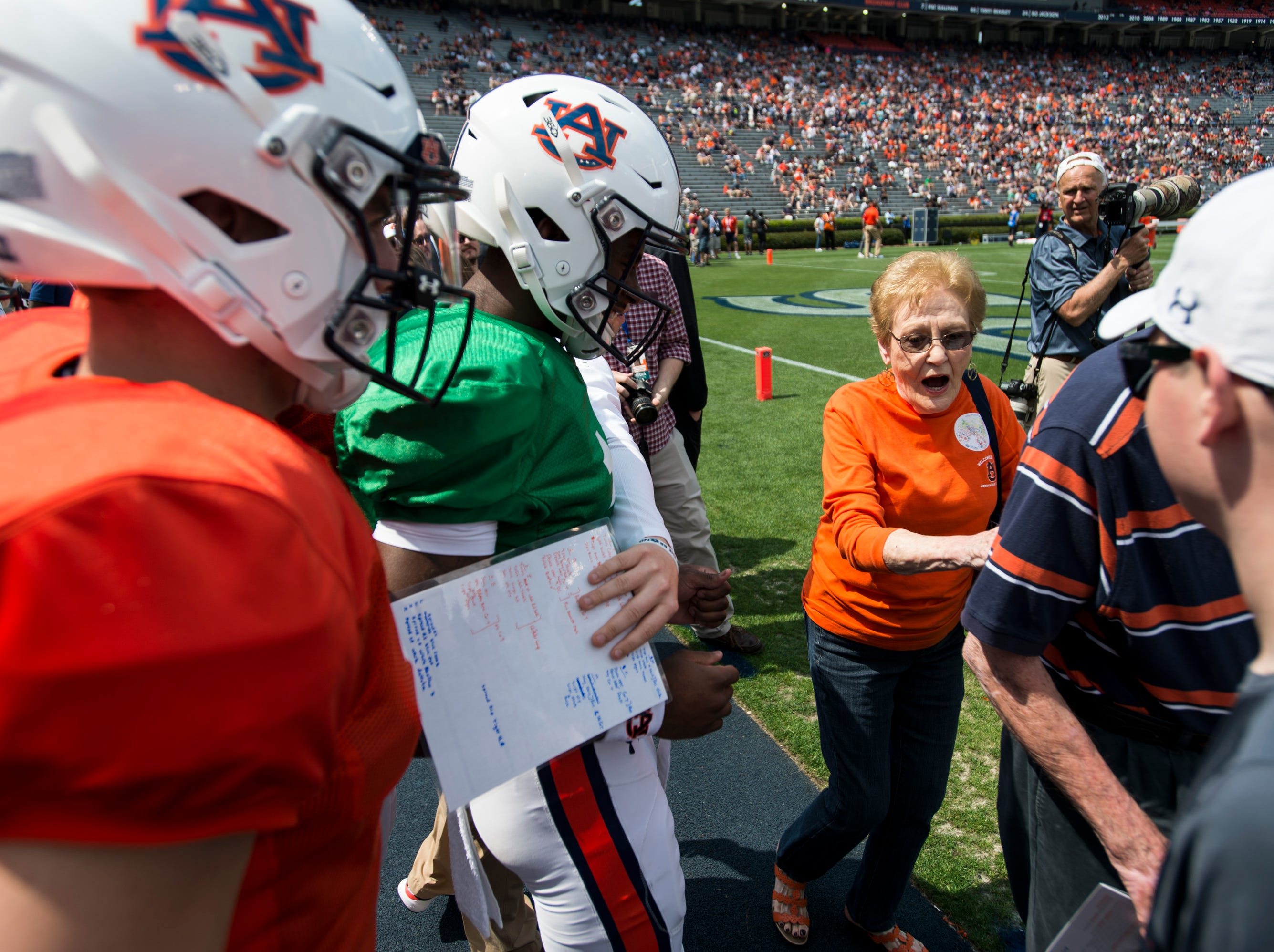 Auburn quarterbacks are halted before they run over fans during the A-Day spring practice gameat Jordan-Hare Stadium in Auburn, Ala., on Saturday, April 13, 2019.