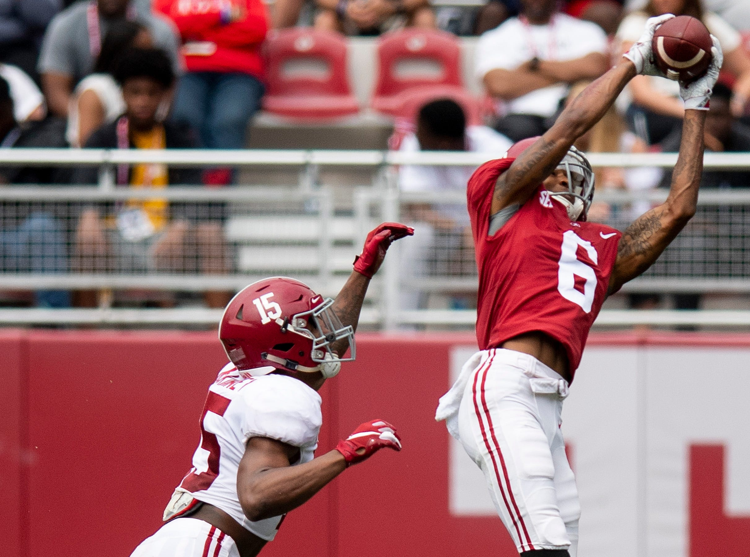 Wide receiver DeVonta Smith (6) catches a pass over defensive back Xavier McKinney (15) during second half action in the Alabama A-Day spring football scrimmage game at Bryant Denny Stadium in Tuscaloosa, Ala., on Saturday April 13, 2019.