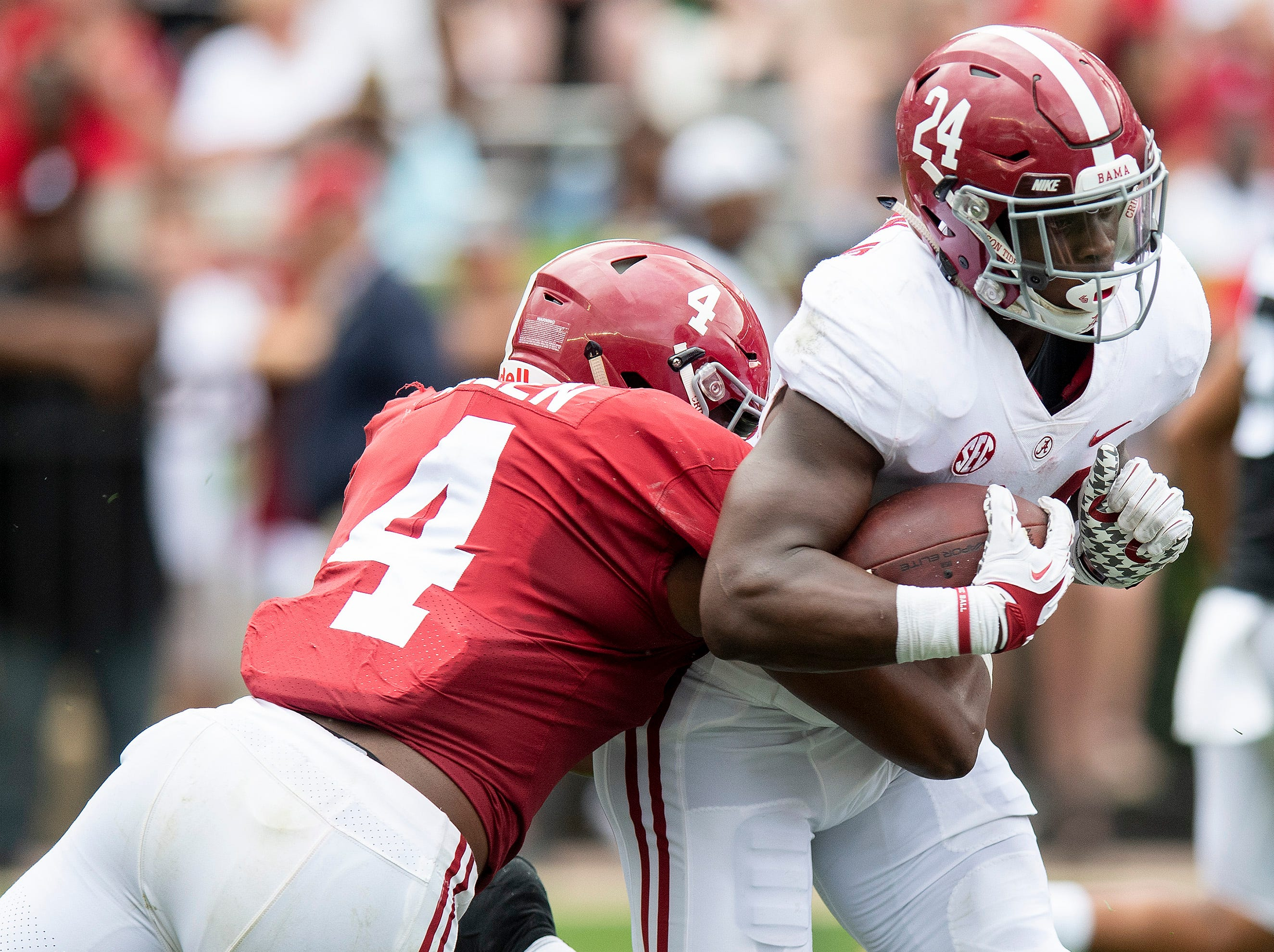 Linebacker Christopher Allen (4) wraps up running back Brian Robinson, Jr., (24) during first half action in the Alabama A-Day spring football scrimmage game at Bryant Denny Stadium in Tuscaloosa, Ala., on Saturday April 13, 2019.