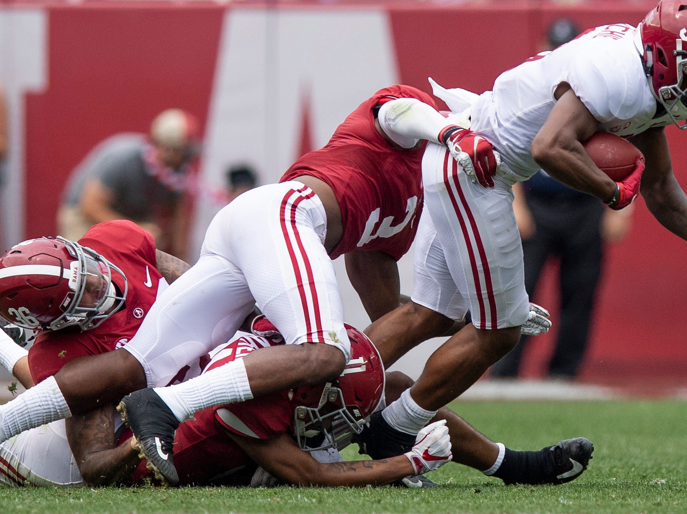 Wide receiver John Metchie (3) is stopped by defensive back Daniel Wright (3) and defensive back Scooby Carter (11) during second half action in the Alabama A-Day spring football scrimmage game at Bryant Denny Stadium in Tuscaloosa, Ala., on Saturday April 13, 2019.