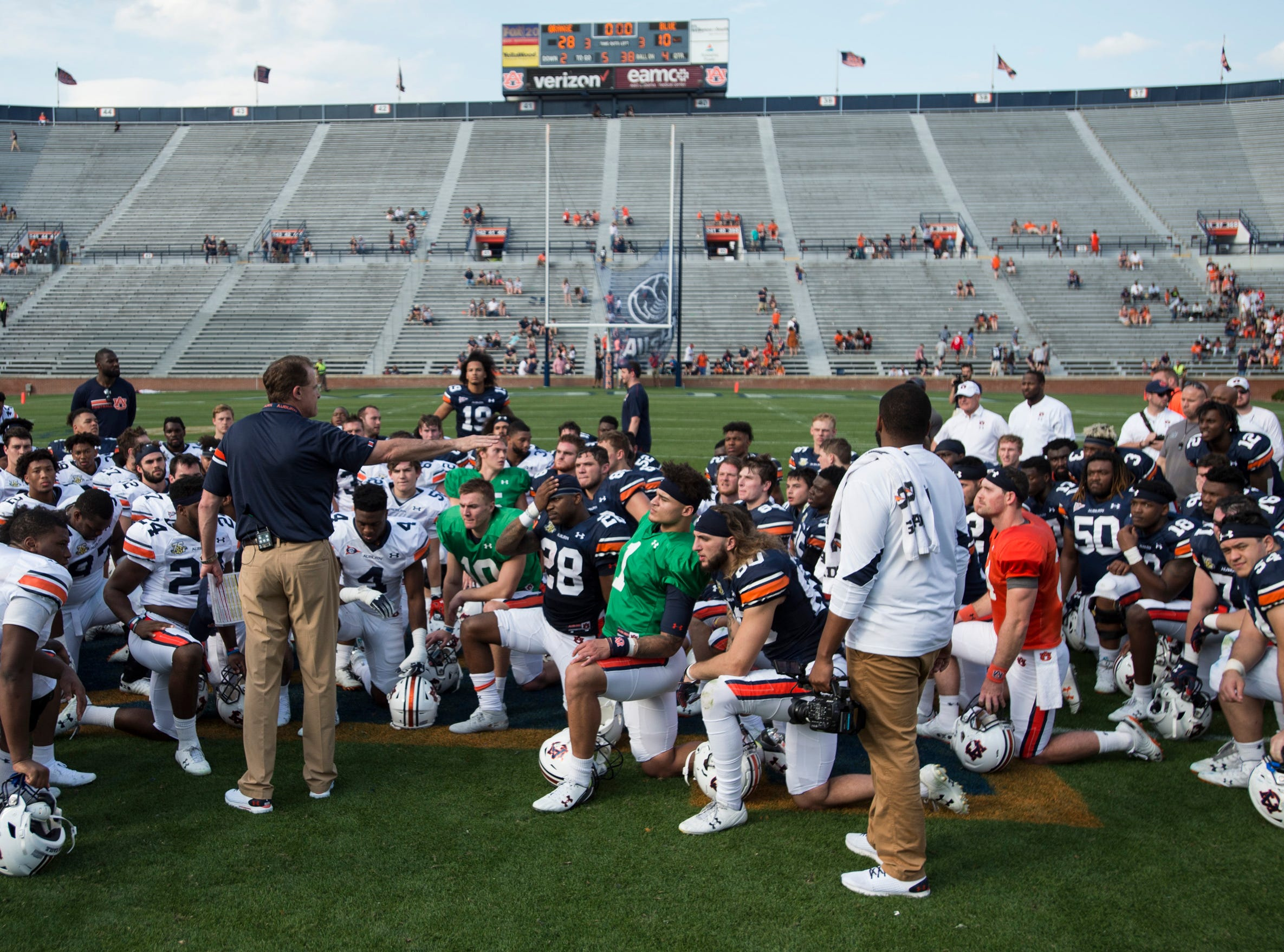 Auburn head coach Gus Malzahn talks with his team after the game during the A-Day spring practice gameat Jordan-Hare Stadium in Auburn, Ala., on Saturday, April 13, 2019.