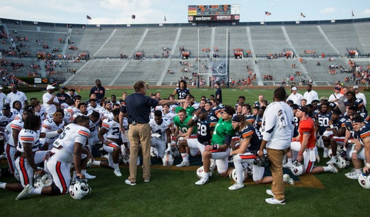 Auburn head coach Gus Malzahn talks with his team after the game during the A-Day spring practice game at Jordan-Hare Stadium in Auburn, Ala., on Saturday, April 13, 2019.
