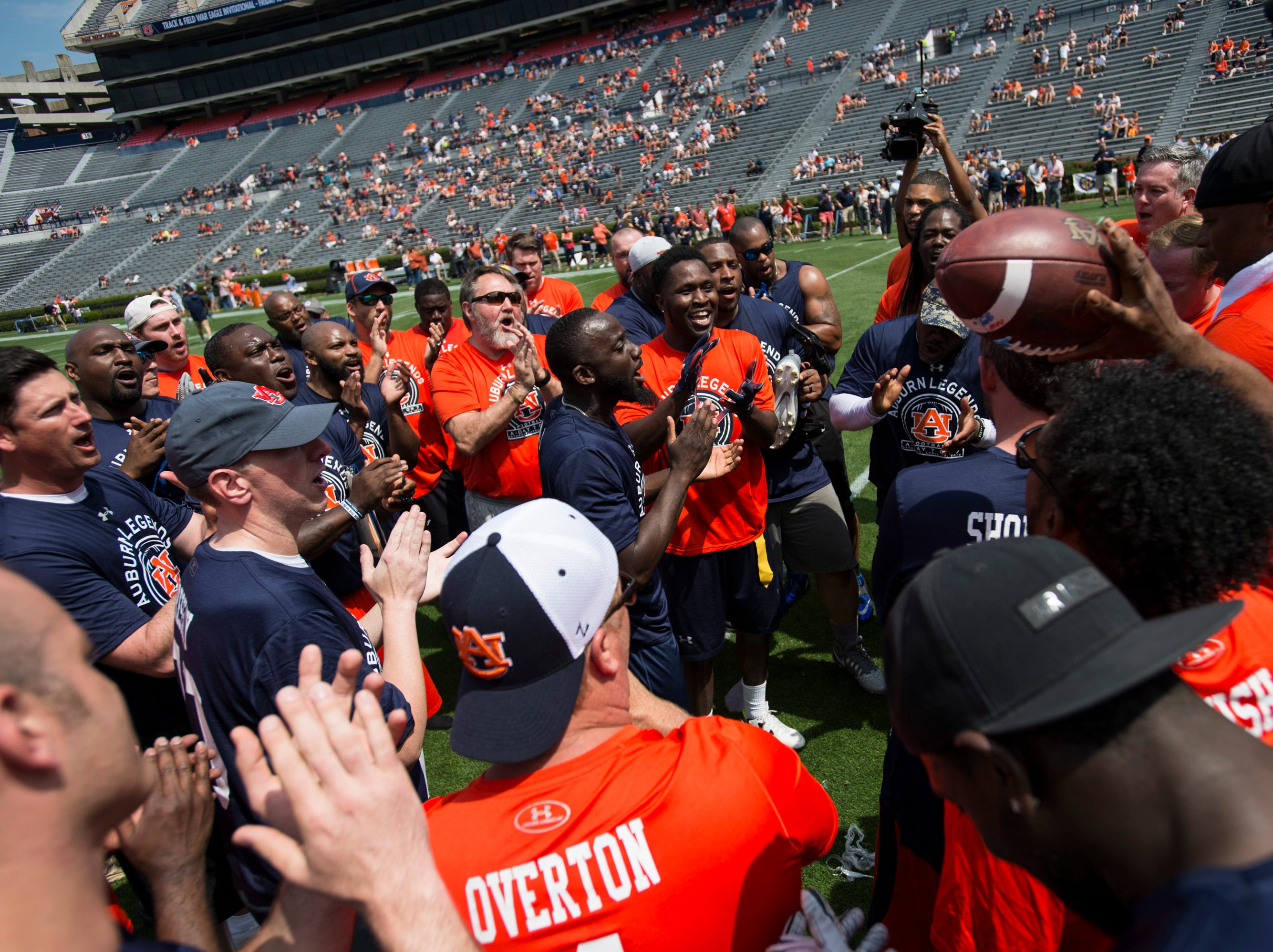 The Auburn Legends teams huddle up after their flag football game during the A-Day spring practice gameat Jordan-Hare Stadium in Auburn, Ala., on Saturday, April 13, 2019.