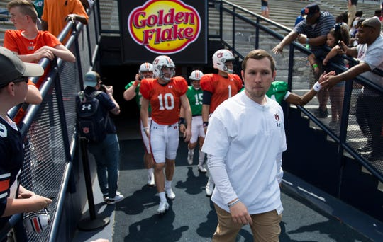 Auburn offensive coordinator Kenny Dillingham leads the quarterbacks onto the field during the A-Day spring practice gameat Jordan-Hare Stadium in Auburn, Ala., on Saturday, April 13, 2019.