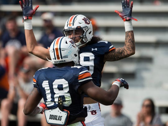 Auburn wide receivers Seth Williams (18) and Matthew Hill (19) celebrate Hill's touchdown catch during the A-Day spring practice gameat Jordan-Hare Stadium in Auburn, Ala., on Saturday, April 13, 2019.