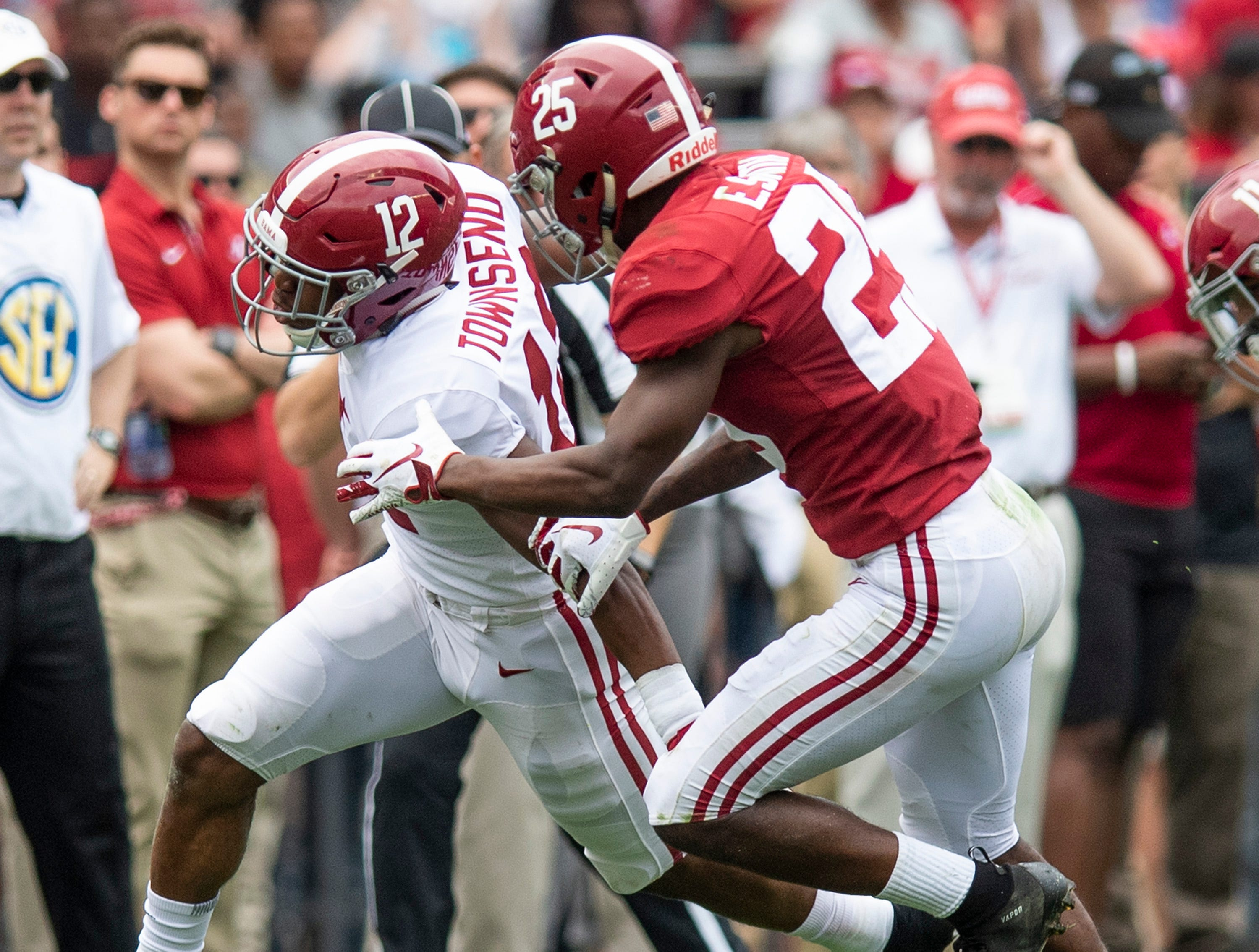 Defensive back Eddie Smith (25) stops wide receiver Chadarius Townsend (12) during second half action in the Alabama A-Day spring football scrimmage game at Bryant Denny Stadium in Tuscaloosa, Ala., on Saturday April 13, 2019.