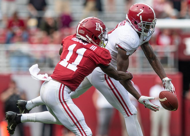 Wide receiver Henry Ruggs, III, (11) breaks up an interception by defensive back Trevon Diggs (7) during second half action in the Alabama A-Day spring football scrimmage game at Bryant Denny Stadium in Tuscaloosa, Ala., on Saturday April 13, 2019.