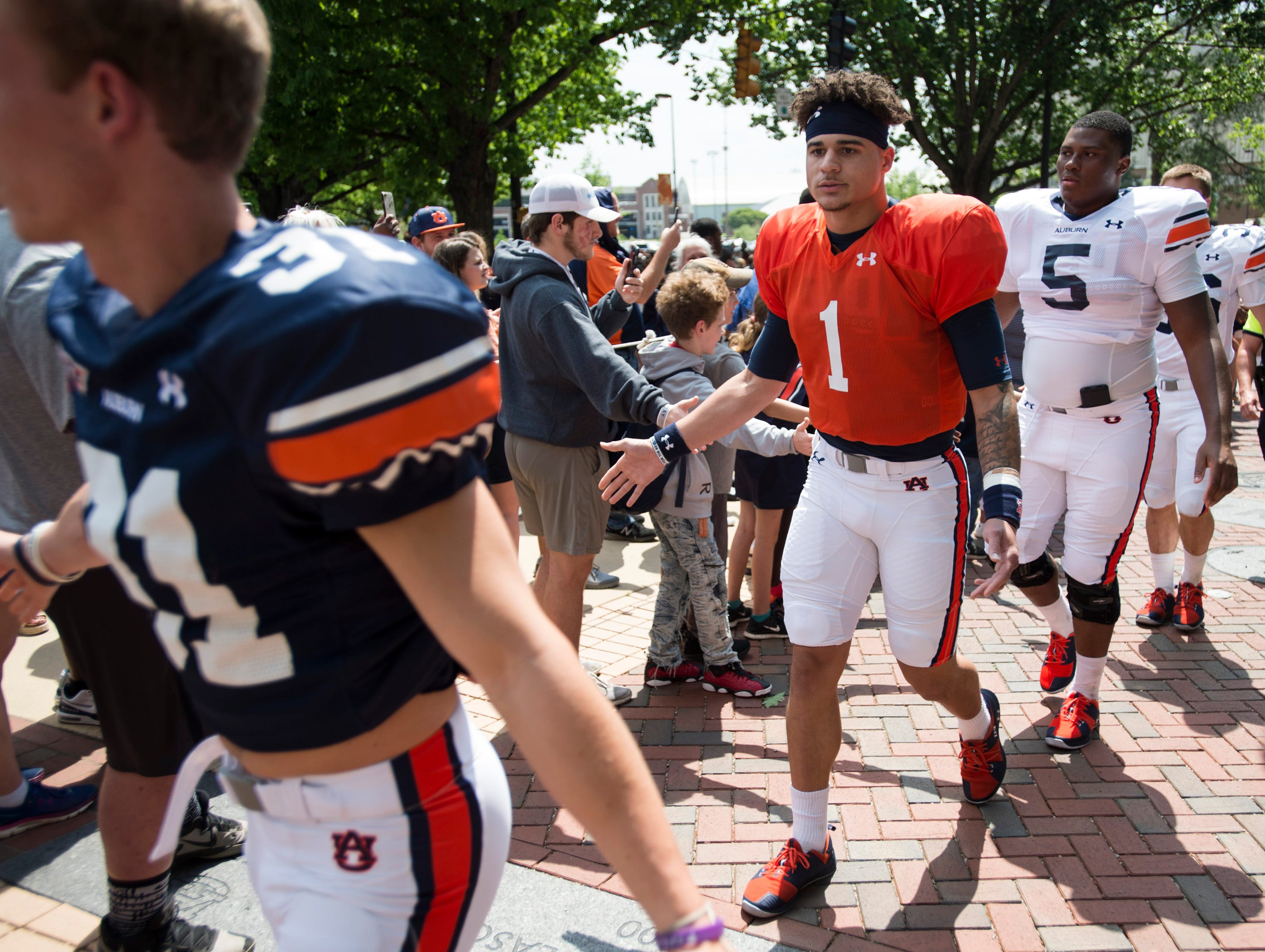 Auburn quarterback Joey Gatewood (1) greets fans during the Tiger Walk during the A-Day spring practice gameat Jordan-Hare Stadium in Auburn, Ala., on Saturday, April 13, 2019.