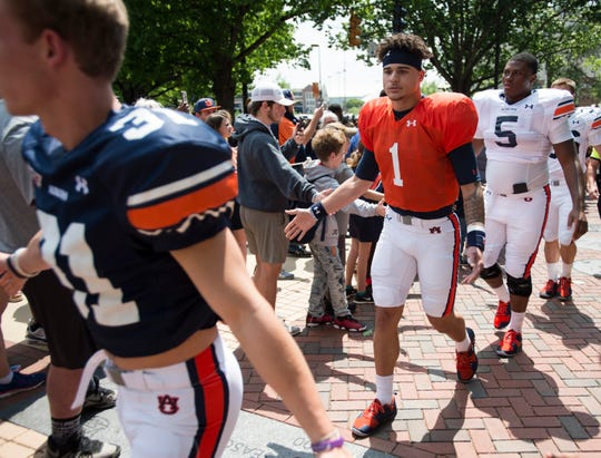 Auburn quarterback Joey Gatewood (1) greets fans during the Tiger Walk before the A-Day spring gam eat Jordan-Hare Stadium in Auburn, Ala., on Saturday, April 13, 2019.