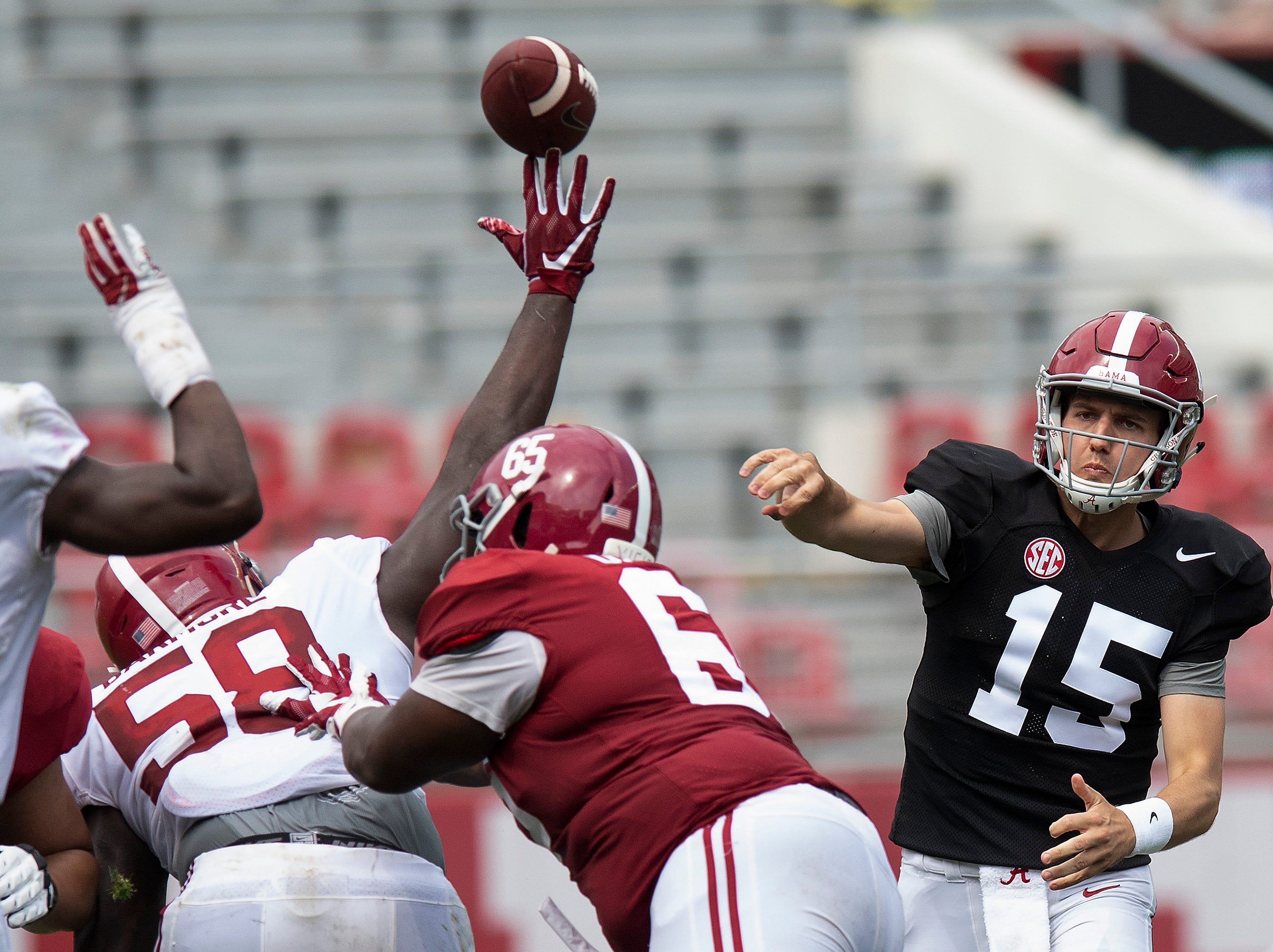A pass by quarterback Paul Tyson (15)  is tipped by defensive lineman Christian Barmore (58) during second half action in the Alabama A-Day spring football scrimmage game at Bryant Denny Stadium in Tuscaloosa, Ala., on Saturday April 13, 2019.