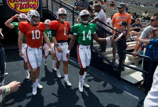 Auburn quarterbacks walk onto the field during the A-Day spring practice gameat Jordan-Hare Stadium in Auburn, Ala., on Saturday, April 13, 2019.