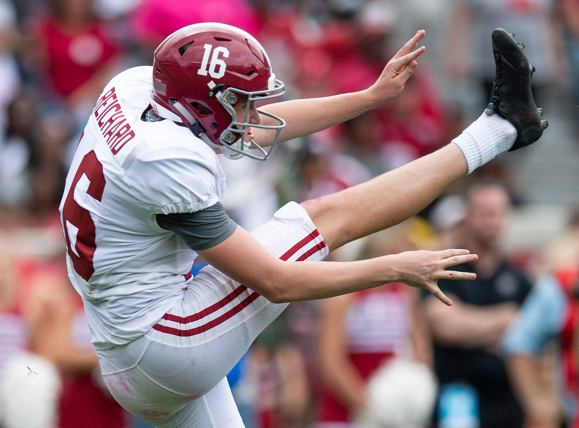 Alabama placekicker Will Reichard (16) punts during first half action in the Alabama A-Day spring football scrimmage game at Bryant Denny Stadium in Tuscaloosa, Ala., on Saturday April 13, 2019.