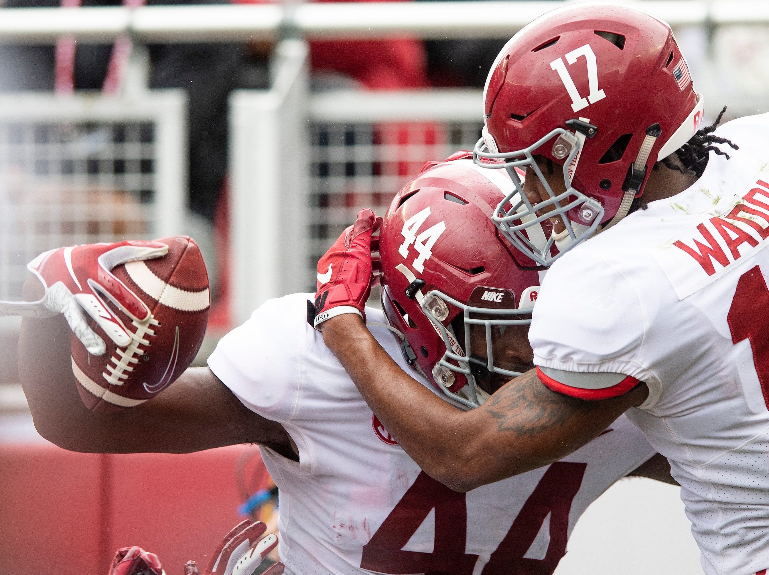 Tight end Kedrick James (44) and wide receiver Jaylen Waddle (17) celebrate James' touchdown during first half action in the Alabama A-Day spring football scrimmage game at Bryant Denny Stadium in Tuscaloosa, Ala., on Saturday April 13, 2019.