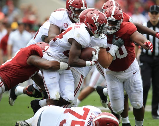 Apr 13, 2019; Tuscaloosa, AL, USA; Alabama Crimson Tide running back Brian Robinson Jr. (24) carries the ball as is grabbed from behind by Alabama Crimson Tide linebacker Christopher Allen (4) at Bryant-Denny Stadium. Mandatory Credit: Marvin Gentry-USA TODAY Sports