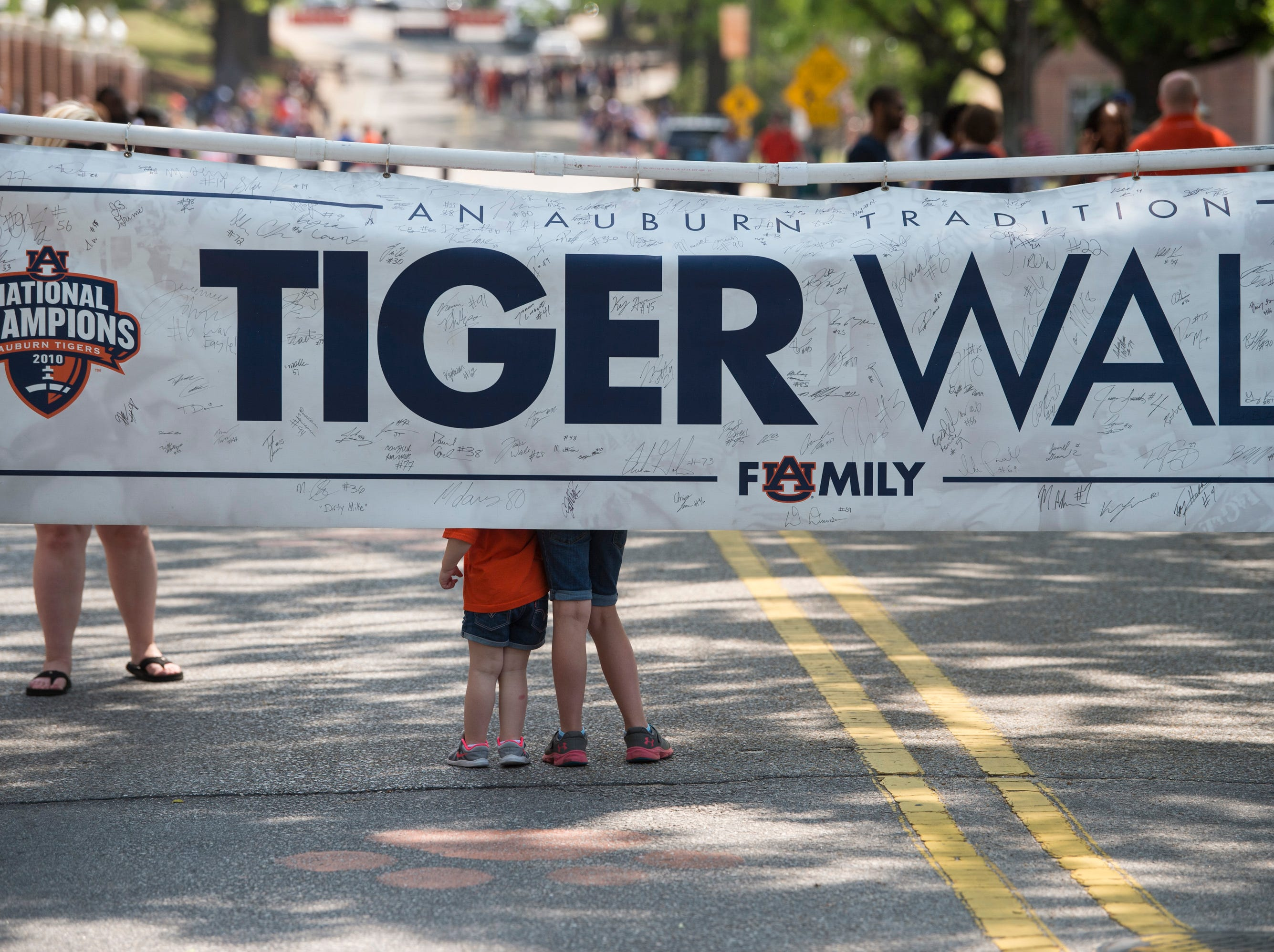 Fans take picture in front of the Tiger Walk sign during the A-Day spring practice gameat Jordan-Hare Stadium in Auburn, Ala., on Saturday, April 13, 2019.