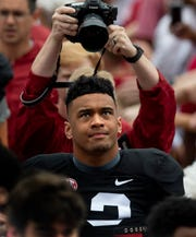 Alabama quarterback Tua Tagovailoa (13) arrives with the team for the A-Day spring scrimmage game at Bryant Denny Stadium in Tuscaloosa, Ala., on Saturday April 13, 2019.