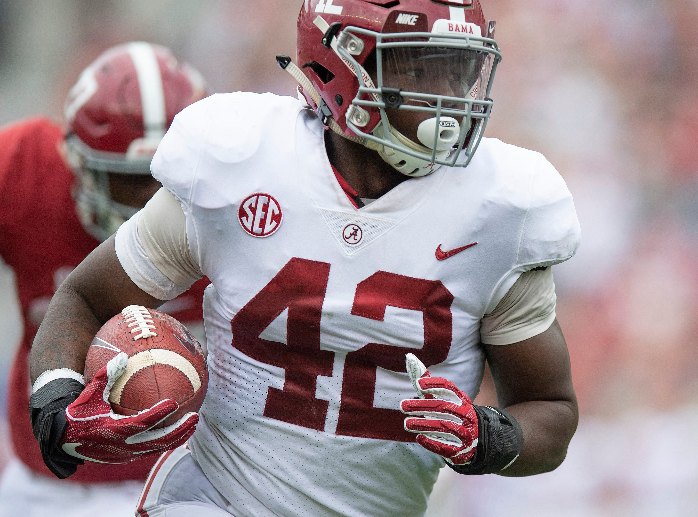Alabama linebacker Jaylen Moody (42) shoes a touchdown on an interception during second half action in the Alabama A-Day spring football scrimmage game at Bryant Denny Stadium in Tuscaloosa, Ala., on Saturday April 13, 2019.