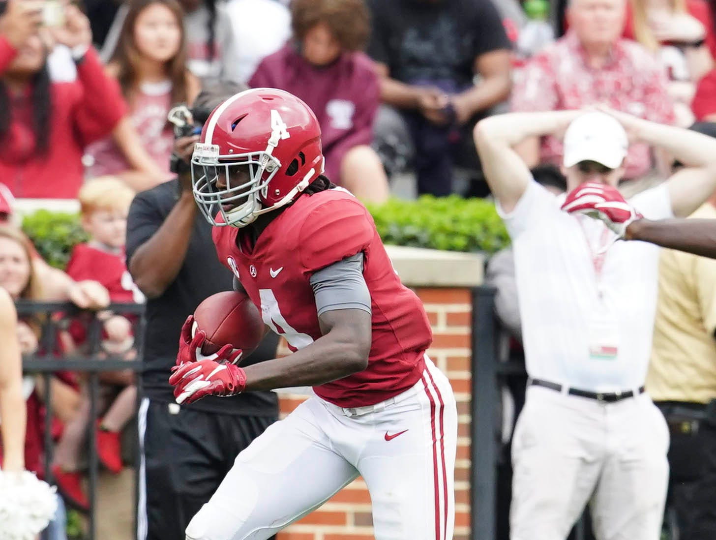 Apr 13, 2019; Tuscaloosa, AL, USA; Alabama Crimson Tide wide receiver Jerry Jeudy (4) carries the ball during the spring game at Bryant-Denny Stadium. Mandatory Credit: Marvin Gentry-USA TODAY Sports
