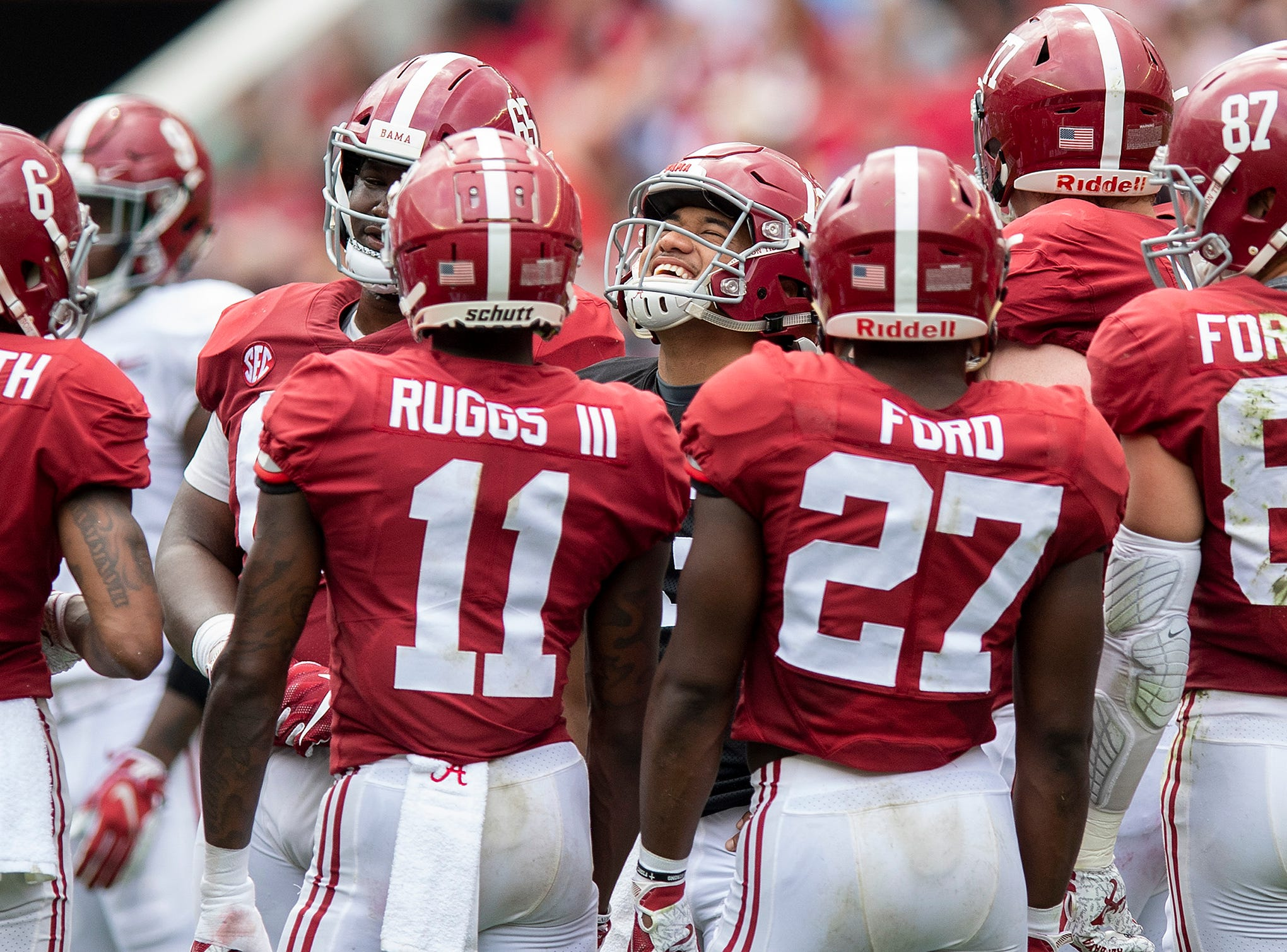 Alabama quarterback Tua Tagovailoa (13) laughs in the huddle during first half action in the Alabama A-Day spring football scrimmage game at Bryant Denny Stadium in Tuscaloosa, Ala., on Saturday April 13, 2019.