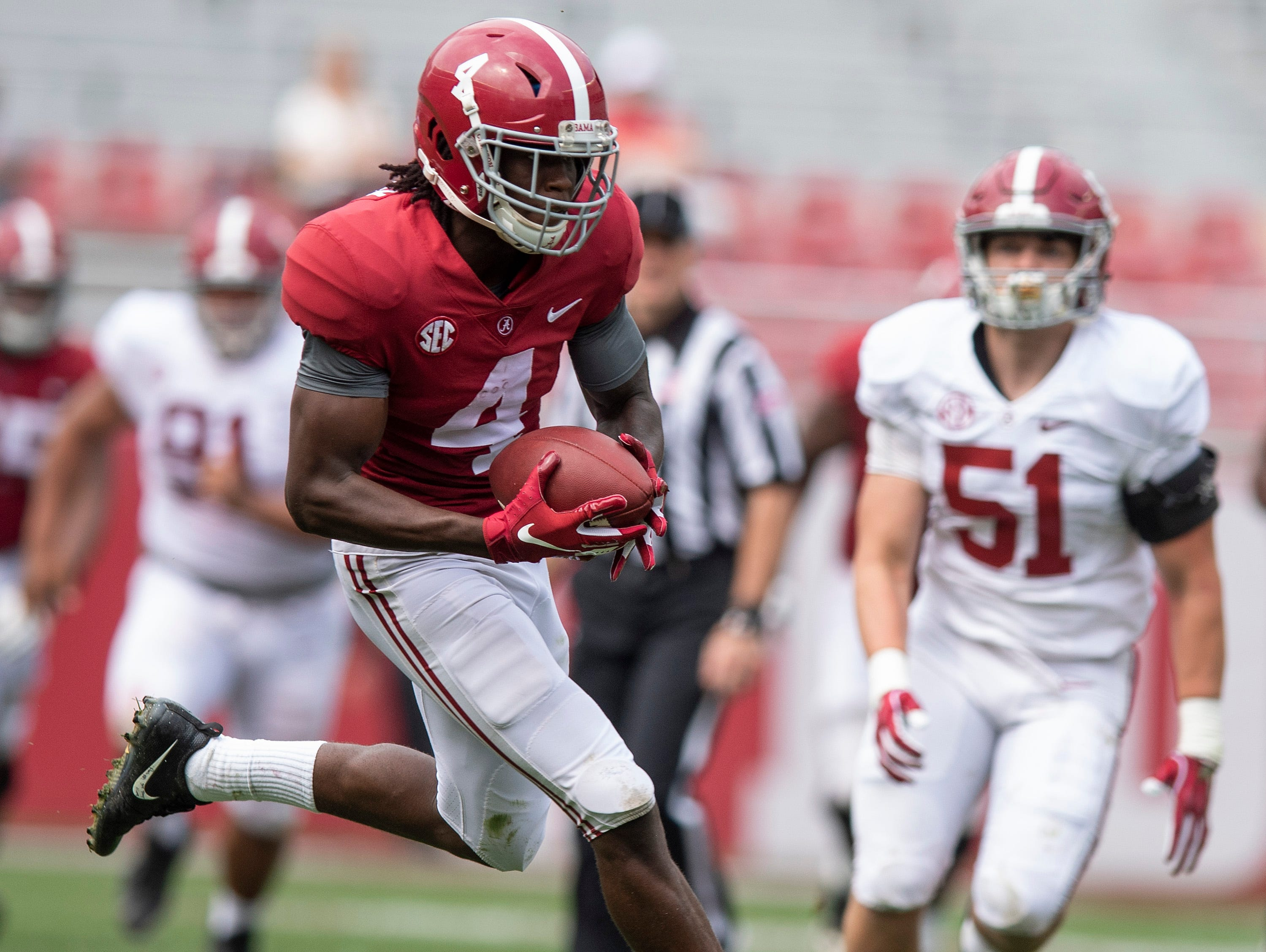 Alabama wide receiver Jerry Jeudy (4) catches a pass for a touchdown during second half action in the Alabama A-Day spring football scrimmage game at Bryant Denny Stadium in Tuscaloosa, Ala., on Saturday April 13, 2019.