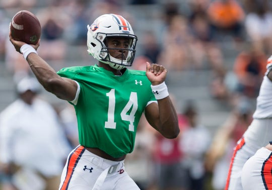 Auburn quarterback Malik Willis (14) throws the ball during the A-Day spring practice gameat Jordan-Hare Stadium in Auburn, Ala., on Saturday, April 13, 2019.