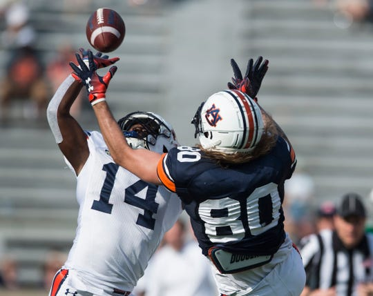 Auburn defensive back Traivon Leonard (14) breaks up a pass intended for Auburn tight end Sal Cannella (80) during the A-Day spring practice gameat Jordan-Hare Stadium in Auburn, Ala., on Saturday, April 13, 2019.