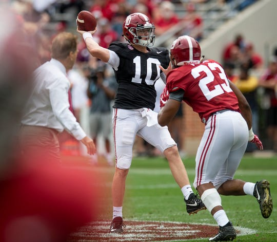 Alabama head coach Nick Saban  watches as quarterback Mac Jones (10) passes against linebacker Jarez Parks (23) during first half action in the Alabama A-Day spring football scrimmage game at Bryant Denny Stadium in Tuscaloosa, Ala., on Saturday April 13, 2019.