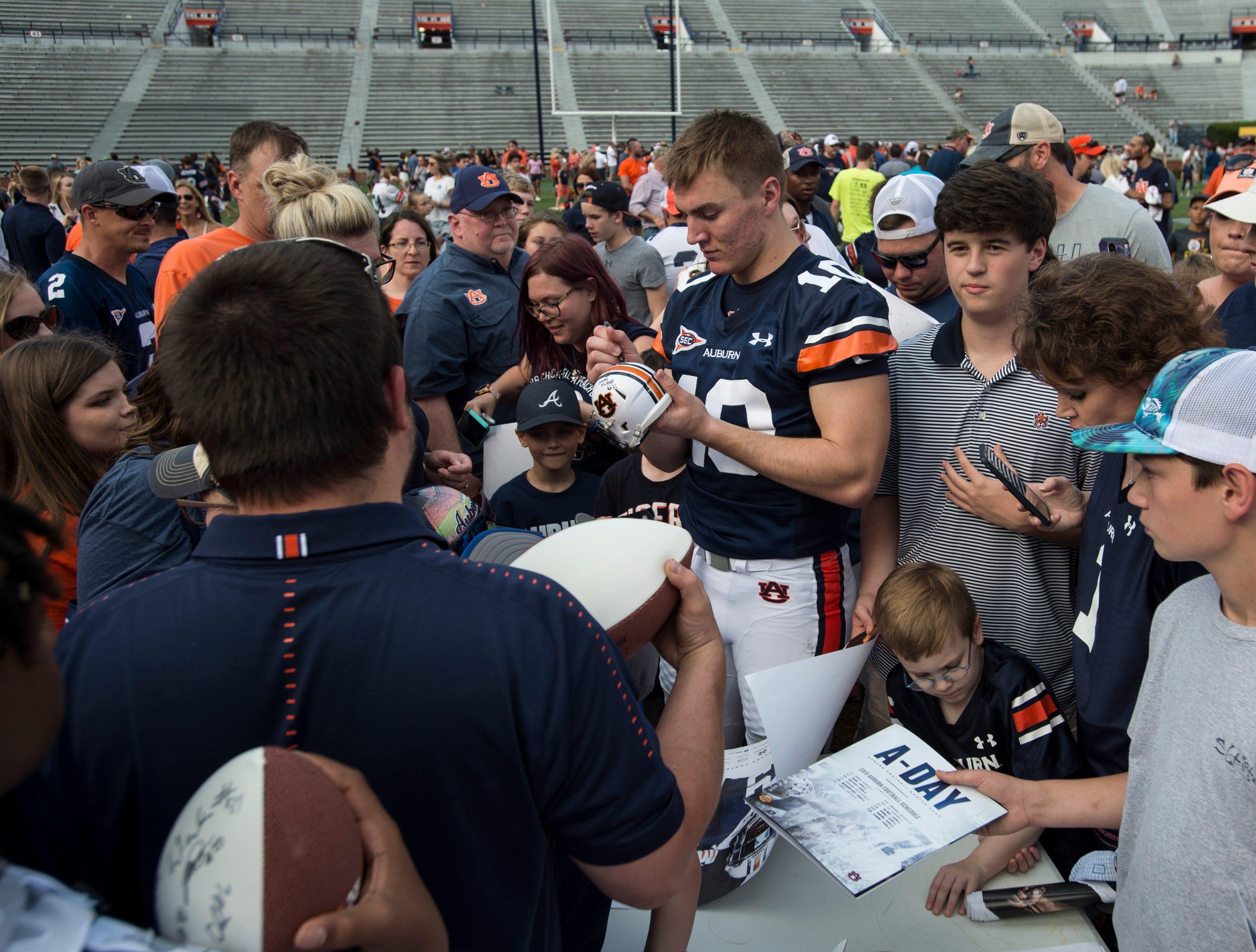 Auburn quarterback Bo Nix (10) signs autographs during the A-Day spring practice gameat Jordan-Hare Stadium in Auburn, Ala., on Saturday, April 13, 2019.