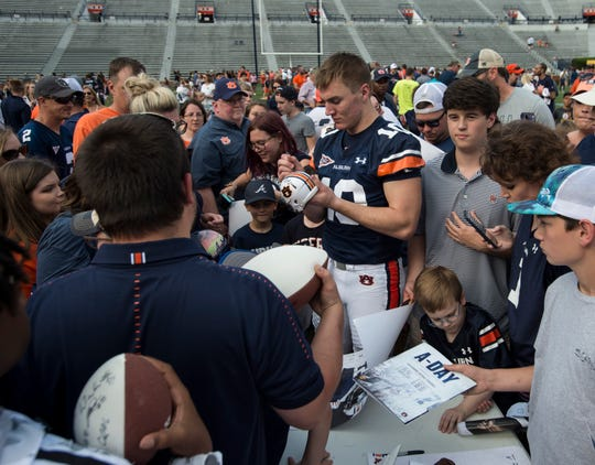 Auburn quarterback Bo Nix (10) signs autographs during the A-Day spring practice gameat Jordan-Hare Stadium in Auburn, Ala., on Saturday, April 13, 2019.