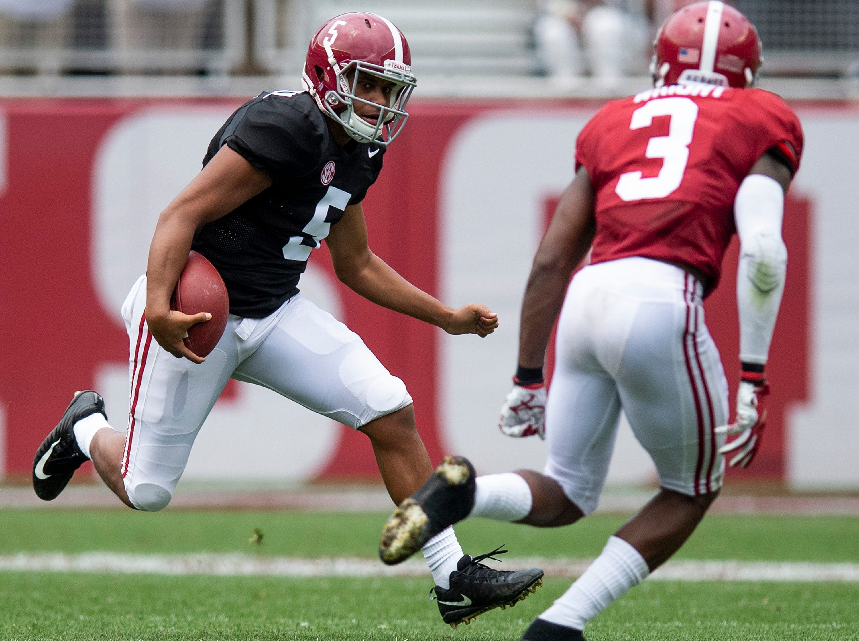 Quarterback Taulia Tagovailoa (5) scrambles during second half action in the Alabama A-Day spring football scrimmage game at Bryant Denny Stadium in Tuscaloosa, Ala., on Saturday April 13, 2019.