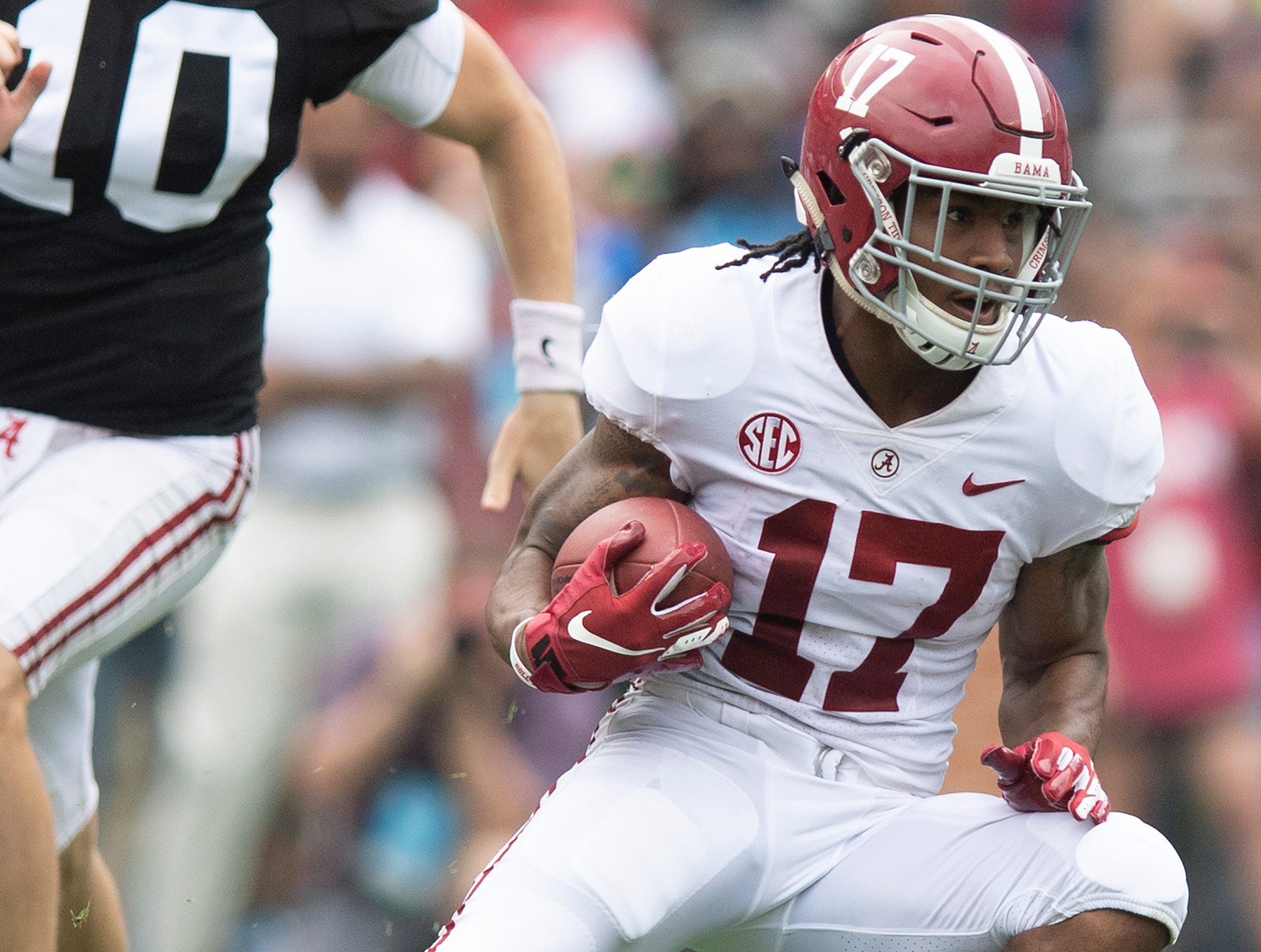 Alabama wide receiver Jaylen Waddle (17) carries the ball during second half action in the Alabama A-Day spring football scrimmage game at Bryant Denny Stadium in Tuscaloosa, Ala., on Saturday April 13, 2019.