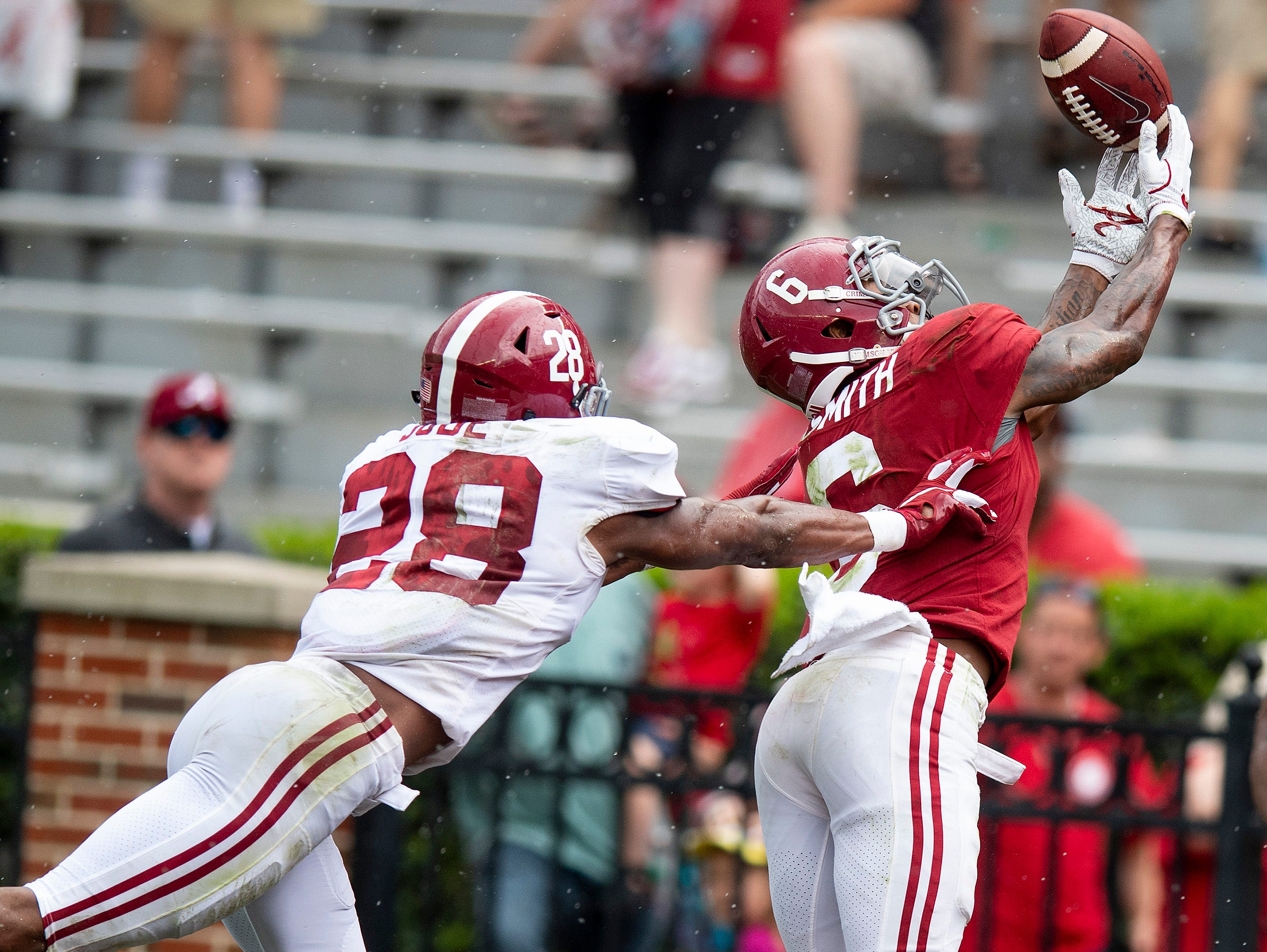 The ball goes off the fingertips of wide receiver DeVonta Smith (6) against defensive back Josh Jobe (28) during second half action in the Alabama A-Day spring football scrimmage game at Bryant Denny Stadium in Tuscaloosa, Ala., on Saturday April 13, 2019.